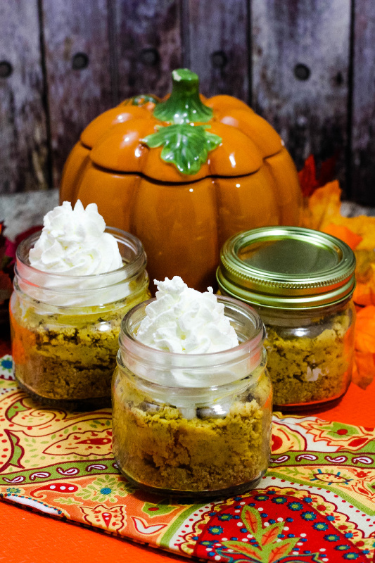 pumpkin on table with No Bake Pumpkin CheeseCake