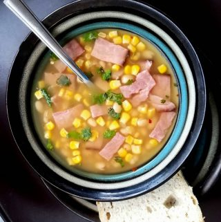 This Crockpot Ham & White Bean Soup is super easy to make and a short ingredient list but don't let fool you, it is bursting with flavor!