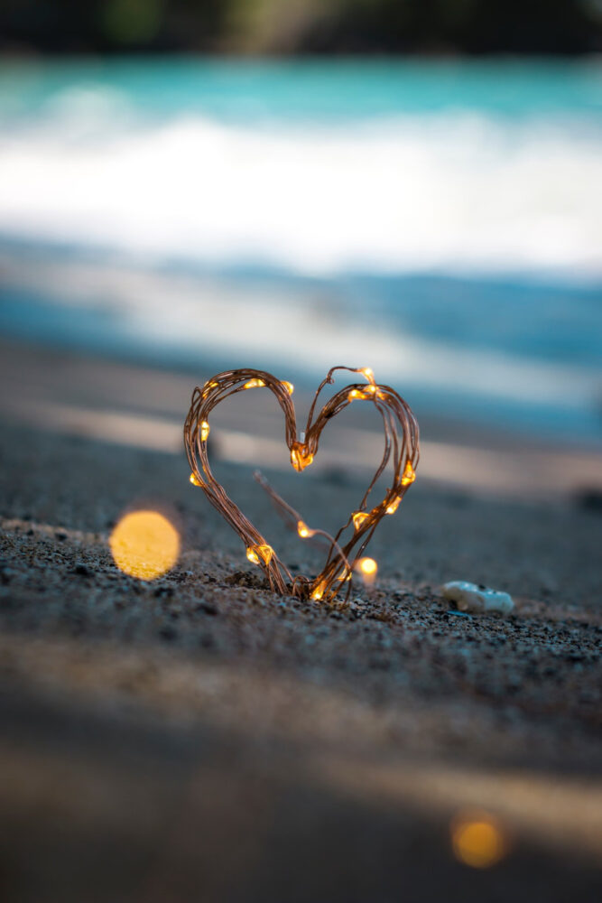 Lights shaped into a heart in sand