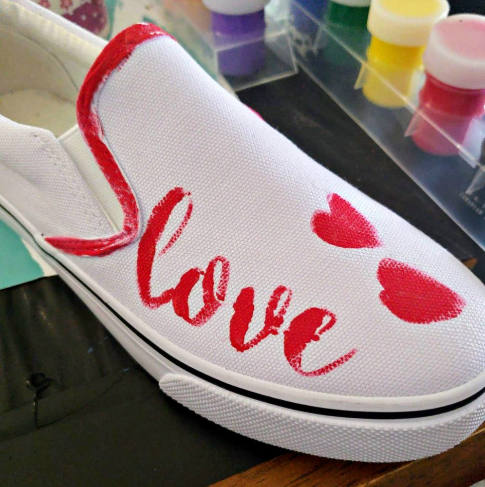 Painted a red stencil of LOVE on a shoe