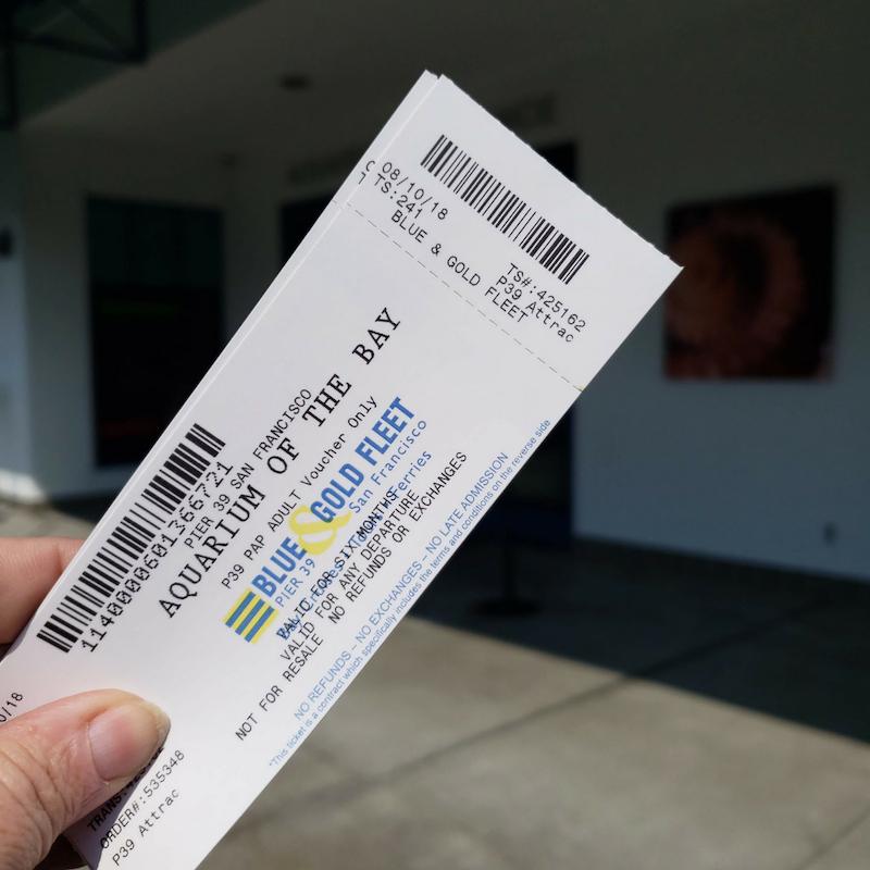Aquarium tickets in front of building