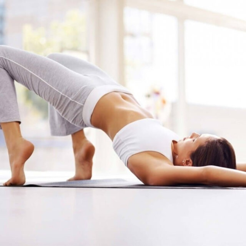 lady doing yoga at home