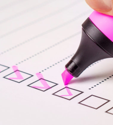 pink marker checking a W 2 form