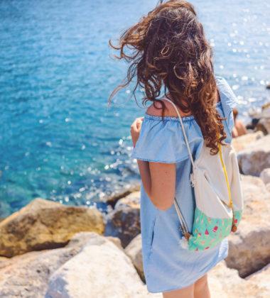 girl holding day bag