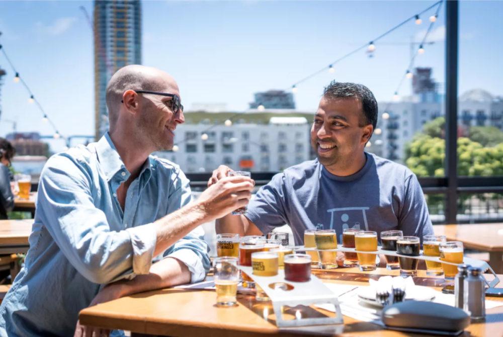 two guys binge drinking