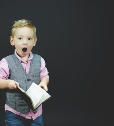 little boy with a book in hand