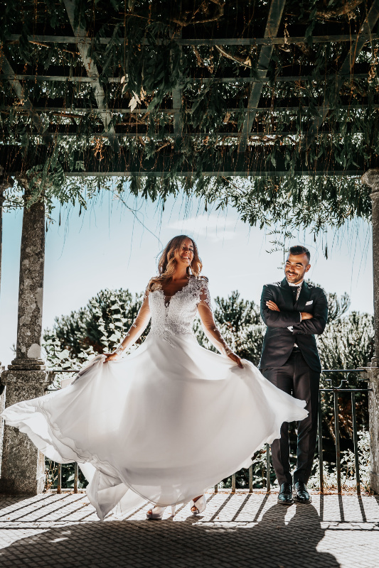 woman wearing white dress beside man wearing formal suit under