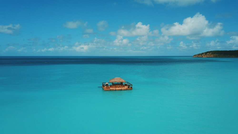 floating house in the middle of sea at daytime