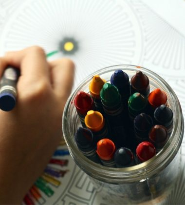 kid coloring and crayons