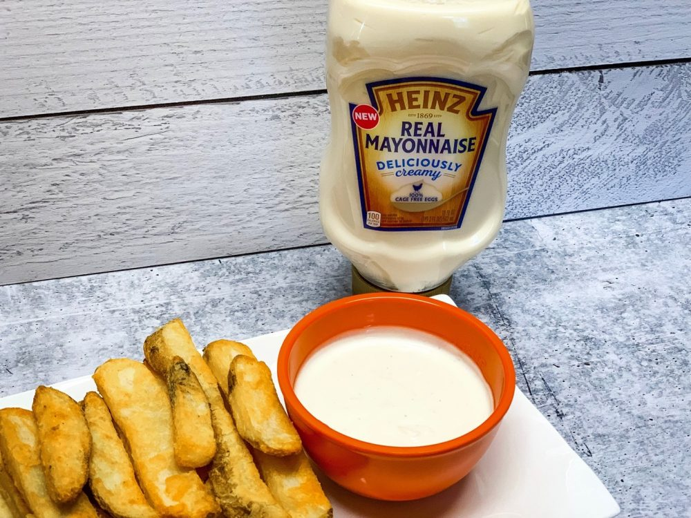 french fries on a plate with dip