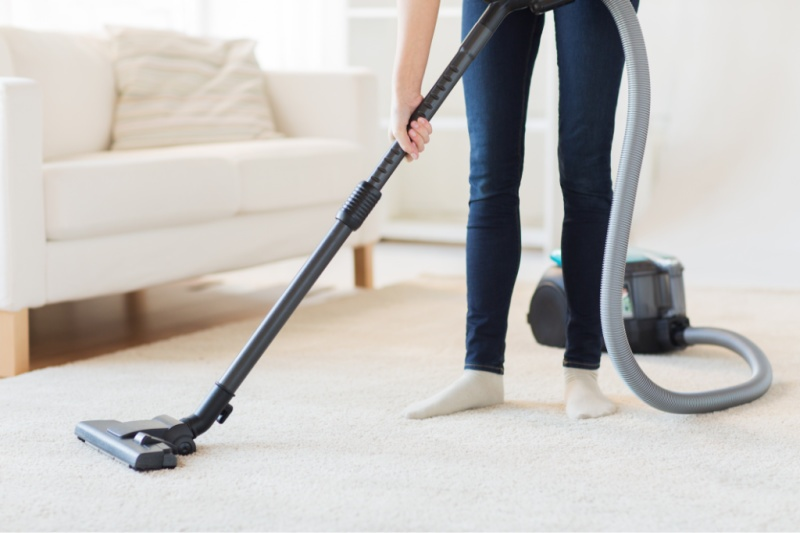 person cleaning the carpets