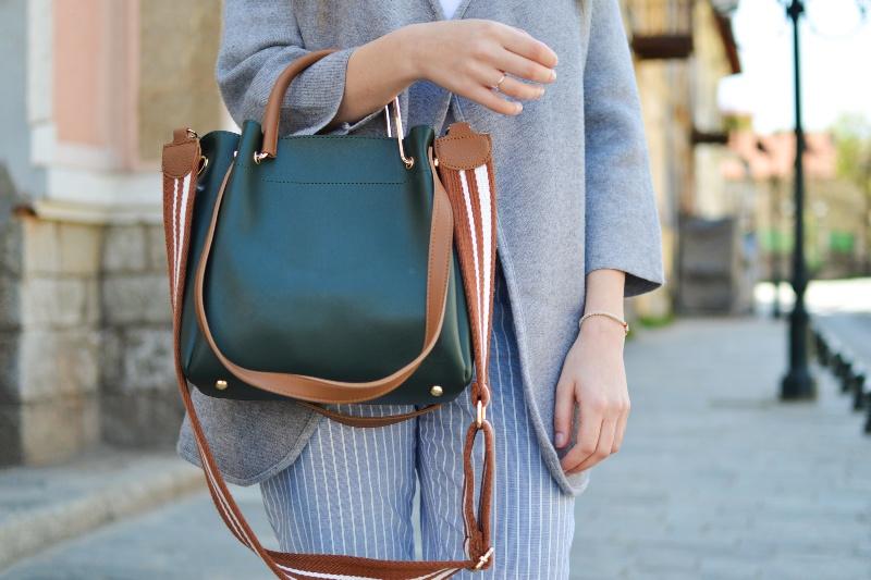 woman holding a black purse