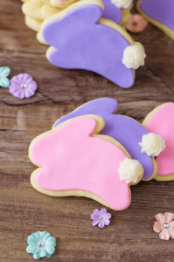 Bunny cookies on a table with flowers