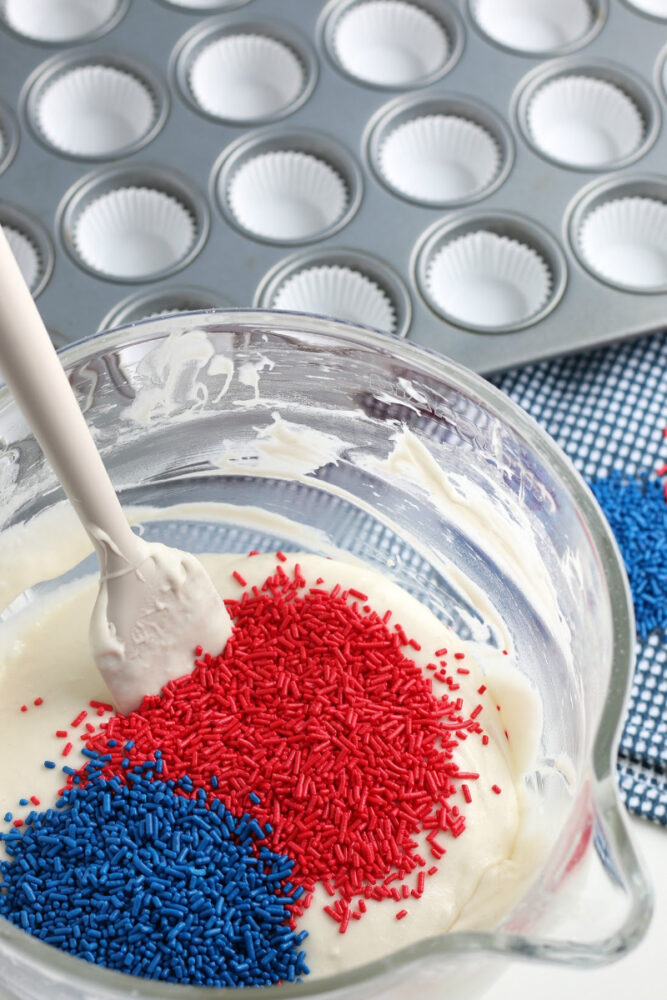 Blue and red Jimmies in mixing bowl