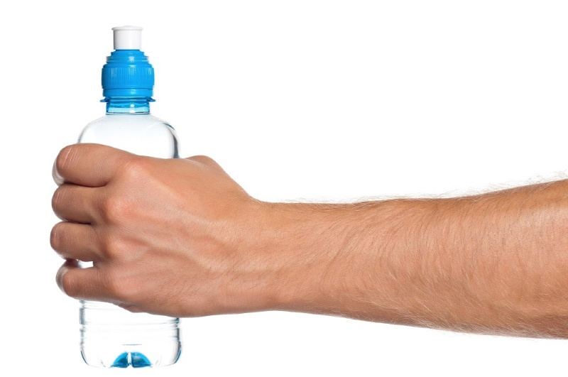 person holding water bottle