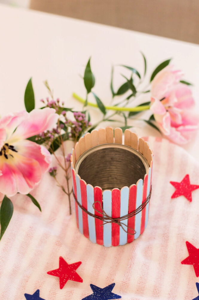 Patriotic Popsicle Stick Vase with flowers laying on table