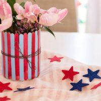 Patriotic Popsicle Stick Vase on table with stars around it