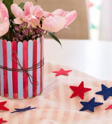 Patriotic Popsicle Stick Vase on table with stars around it