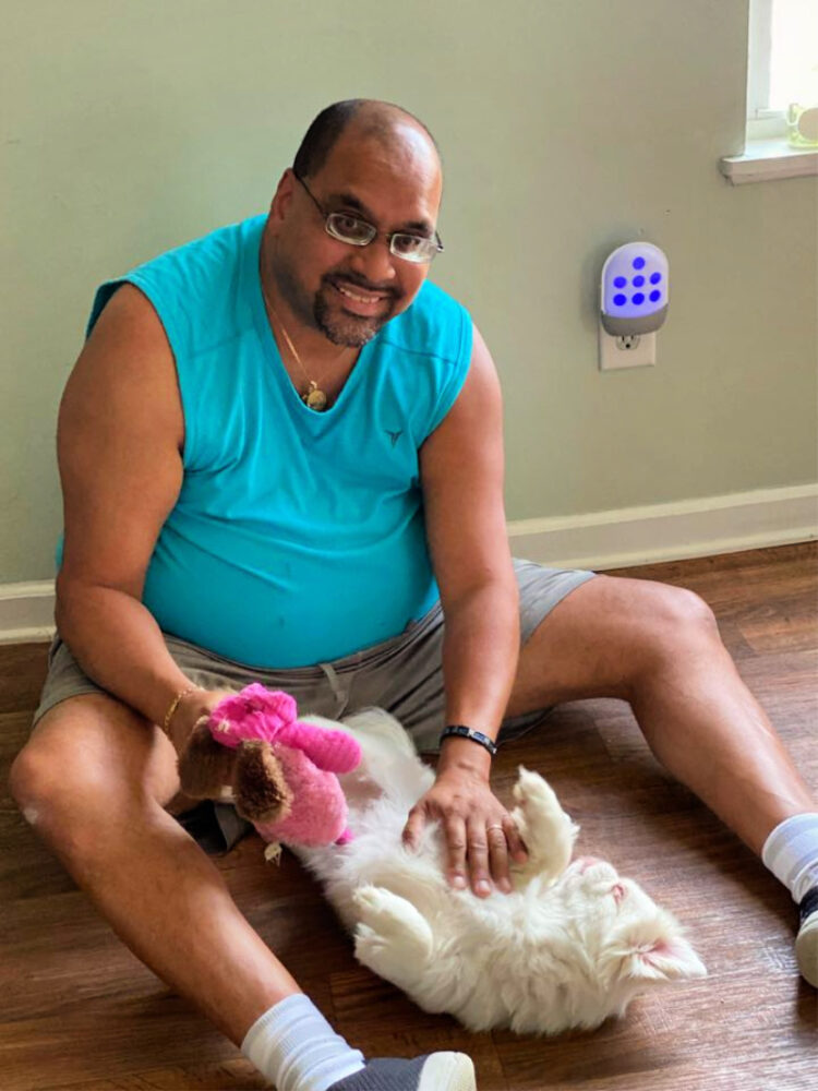 man playing with a dog.
