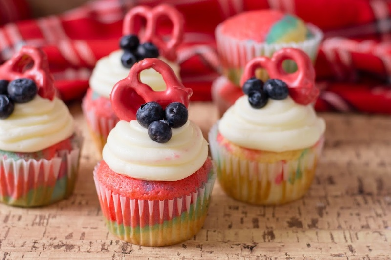 Tie Dye Patriotic Cupcakes with red pretzels