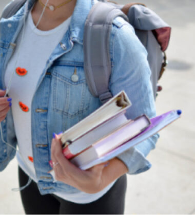girl walking with books