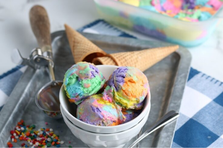Rainbow ice cream in a bowl with cones