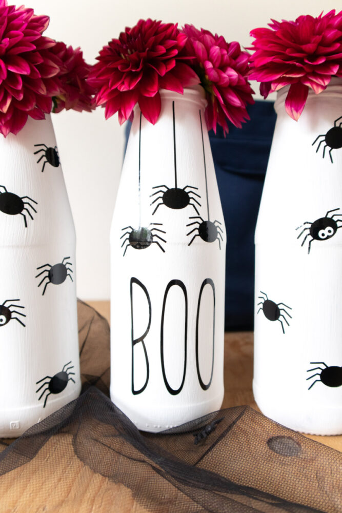 Spider vase with flowers in them