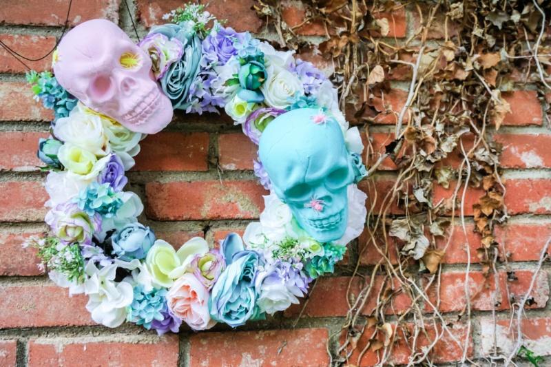 pastel wreath on brick wall