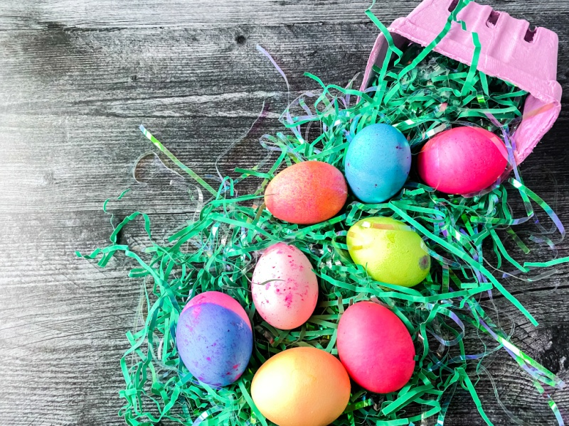 colored eggs on fake grass