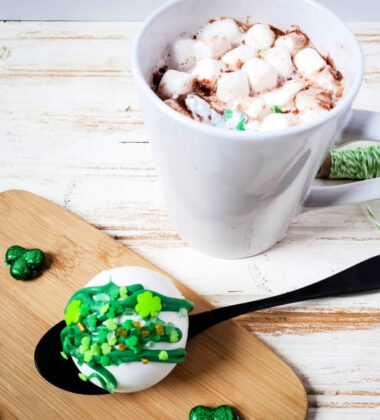 St. Patrick's Day Hot Cocoa Bombs on a spoon