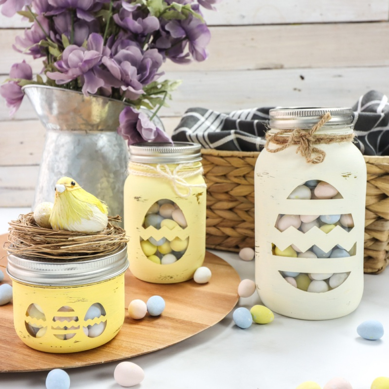 Cricut Chalky Painted Easter Candy Jars sitting on a white table