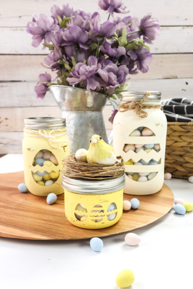 Cricut Chalky Painted Easter Candy Jars on a table