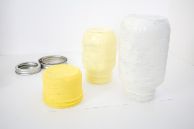 yellow painted glass jars
