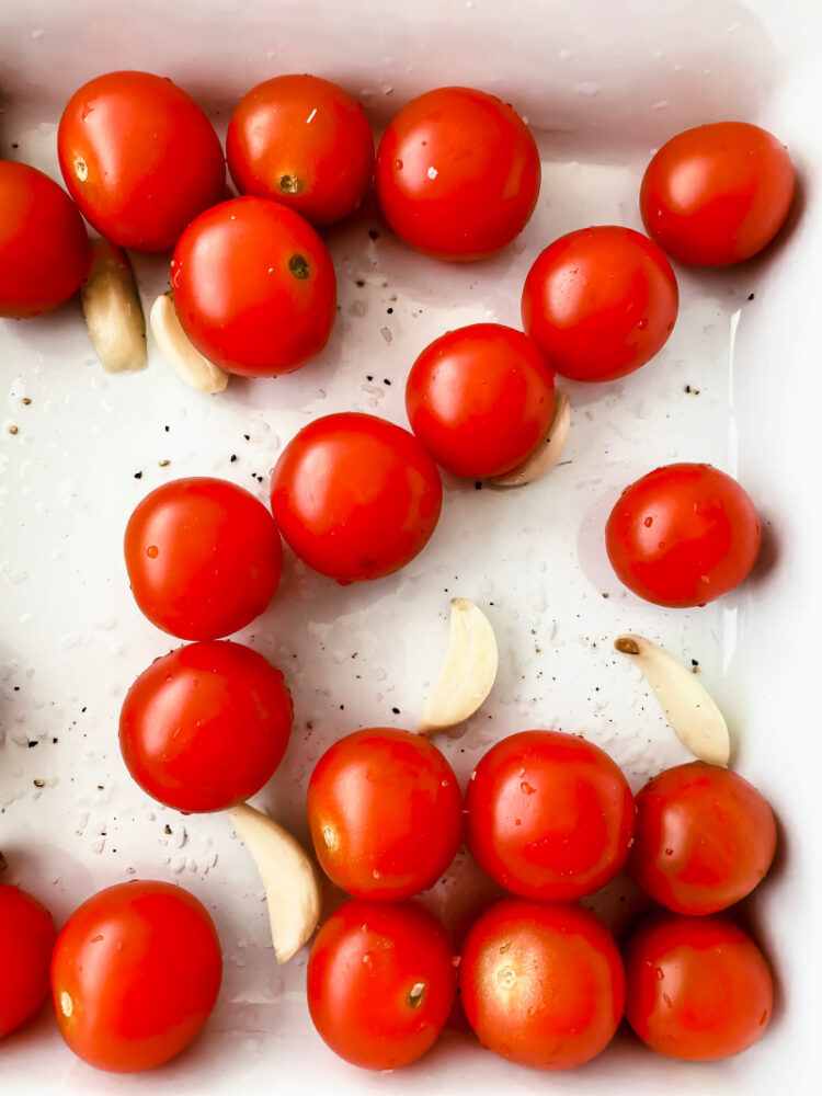cherry tomatoes and garlic in a pan
