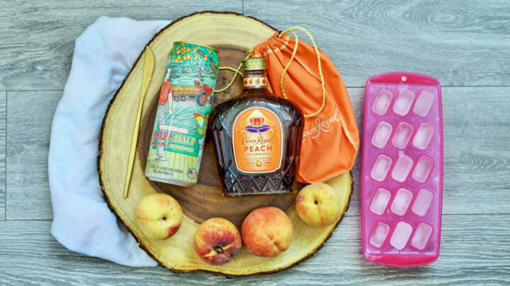peaches and crown royal on a table