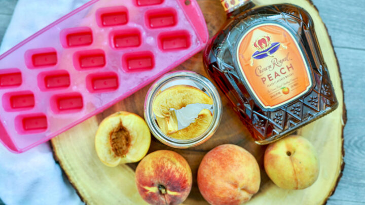 peaches and ice in a glass
