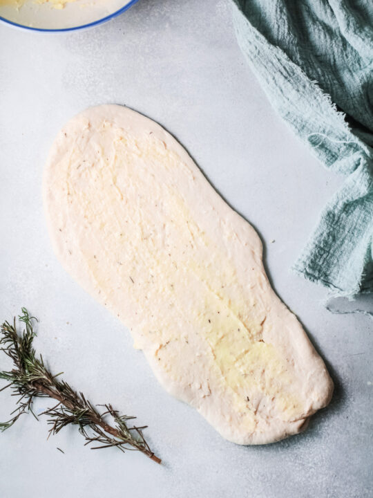 herbed butter on dough