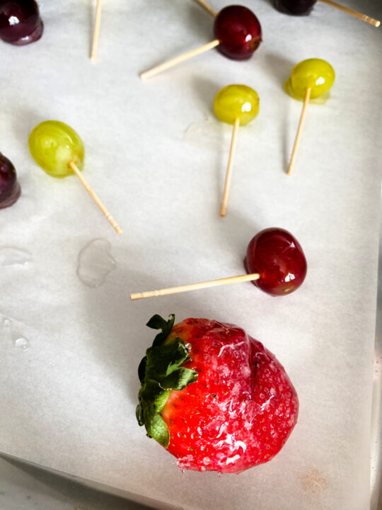 strawberry and grapes on paper